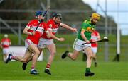 13 September 2020; Phelim Duffin of Dunloy races clear of James McNaughton, left, and Declan mcCloskey of Loughgiel during the Antrim County Senior Hurling Championship Final match between Dunloy Cuchullains and Loughgiel Shamrocks at Páirc Mhic Uilín in Ballycastle, Antrim. Photo by Brendan Moran/Sportsfile