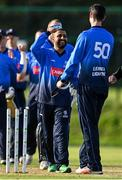 17 September 2020; Simi Singh of Leinster Lightning, centre, is congratulated by George Dockrell after bowling and catching Graeme McCarter of Northern Knights to win the game following the Test Triangle Inter-Provincial 50- Over Series 2020 match between Leinster Lightning and Northern Knights at Comber in Down. Photo by Sam Barnes/Sportsfile