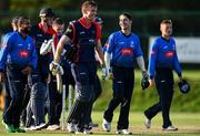 17 September 2020; Matthew Foster of Northern Knights, centre left, and Curtis Campher of Leinster Lightning share a joke following the Test Triangle Inter-Provincial 50- Over Series 2020 match between Leinster Lightning and Northern Knights at Comber in Down. Photo by Sam Barnes/Sportsfile