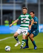 17 September 2020; Jack Byrne of Shamrock Rovers in action against Davide Calabria of AC Milan during the UEFA Europa League Second Qualifying Round match between Shamrock Rovers and AC Milan at Tallaght Stadium in Dublin. Photo by Seb Daly/Sportsfile