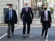 18 September 2020; FAI Director of Communications Cathal Dervan, left, FAI Interim Chief Executive Gary Owens and League of Ireland Director Mark Scanlon, right, on arrival at Dáil Éireann, in Dublin, where representatives from the FAI, GAA & IRFU sporting bodies are to make a collaborative proposal to Government on a roadmap for the safe return of supporters to stadia in Ireland. Photo by Stephen McCarthy/Sportsfile