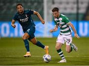 17 September 2020; Jack Byrne of Shamrock Rovers in action against Hakan Çalhanoglu of AC Milan during the UEFA Europa League Second Qualifying Round match between Shamrock Rovers and AC Milan at Tallaght Stadium in Dublin. Photo by Stephen McCarthy/Sportsfile