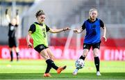 18 September 2020; Leanne Kiernan, left, challenges for the ball with Amber Barrett during a Republic of Ireland women's training session at Stadion Essen in Essen, Germany. Photo by Lukas Schulze/Sportsfile