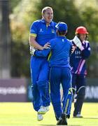 19 September 2020; Jordan McGonigle of Donemana, left, celebrates with Billy Dougherty after the pair combined to take the wicket of Simi Singh of YMCA during the All-Ireland T20 Cup Final match between YMCA and  Donemana at CIYMS Cricket Club in Belfast. Photo by Sam Barnes/Sportsfile
