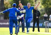 19 September 2020; Jordan McGonigle of Donemana, centre, celebrates with Billy Dougherty after the pair combined to take the wicket of Simi Singh of YMCA during the All-Ireland T20 Cup Final match between YMCA and  Donemana at CIYMS Cricket Club in Belfast. Photo by Sam Barnes/Sportsfile