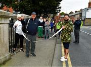19 September 2020; Laura Shearer and her husband Ricky hold a tape as her dad and former international athlete Frank Greally, who fifty years ago set a 10,000 metres National Junior record of 30:17, at the finish of 'Gratitude Road', a walk from Ballyhaunis in Mayo, via the Coombe Women & Infants University Hospital, and back to The Old Coombe Hospital site on The Coombe in Dublin. Photo by Ray McManus/Sportsfile