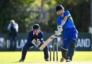 19 September 2020; Dwayne McGerrigle of Donemana plays a shot watched by JJ Cassidy of YMCA during the All-Ireland T20 Cup Final match between YMCA and Donemana at CIYMS Cricket Club in Belfast. Photo by Sam Barnes/Sportsfile