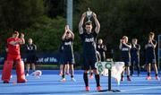 19 September 2020; Lisnagarvey captain James Corry lifts the trophy following his side's victory during the Men's Hockey Irish Senior Cup Final match between Lisnagarvey and UCD at Lisnagarvey Hockey Club in Lisburn, Down. Photo by Seb Daly/Sportsfile