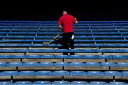 20 September 2020; Slawomir, an employee of Ryan's Cleaning, cleans the seats before the Tipperary County Senior Hurling Championship Final match between Kiladangan and Loughmore-Castleiney at Semple Stadium in Thurles, Tipperary. Photo by Ray McManus/Sportsfile