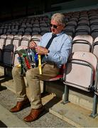 20 September 2020; Tim Floyd, Tipperary County Board Secretary, ties the ribbons of the teams to the Dan Breen Cup before the Tipperary County Senior Hurling Championship Final match between Kiladangan and Loughmore-Castleiney at Semple Stadium in Thurles, Tipperary. Photo by Ray McManus/Sportsfile