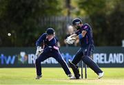 20 September 2020; Nigel Jones of CIYMS plays a shot watched by JJ Cassidy of YMCA during the All-Ireland T20 European Cricket League Play-Off match between CIYMS and YMCA at CIYMS Cricket Club in Belfast. Photo by Sam Barnes/Sportsfile
