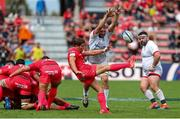 20 September 2020; Antoine Dupont of Toulouse kicks the ball under pressure from Iain Henderson of Ulster during the Heineken Champions Cup Quarter-Final match between Toulouse and Ulster at Stade Ernest Wallon in Toulouse, France. Photo by Manuel Blondeau/Sportsfile