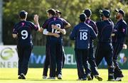 20 September 2020; Ted Britton, centre left, and Jacob Mulder of CIYMS embrace as they celebrate with team-mates after combining to take the wicket of Simi Singh of YMCA during the All-Ireland T20 European Cricket League Play-Off match between CIYMS and YMCA at CIYMS Cricket Club in Belfast. Photo by Sam Barnes/Sportsfile