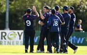 20 September 2020; Ted Britton of CIYMS, centre left, and celebrates with team-mates after taking the wicket of Simi Singh of YMCA, who was caught by Jacob Mulder of CIYMS during the All-Ireland T20 European Cricket League Play-Off match between CIYMS and YMCA at CIYMS Cricket Club in Belfast. Photo by Sam Barnes/Sportsfile