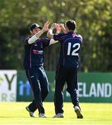 20 September 2020; Ted Britton, left, and Jacob Mulder of CIYMS celebrate after combining to take the wicket of Simi Singh of YMCA during the All-Ireland T20 European Cricket League Play-Off match between CIYMS and YMCA at CIYMS Cricket Club in Belfast. Photo by Sam Barnes/Sportsfile