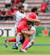 20 September 2020; Yoanne Huget of Toulouse is tackled by John Cooney, right, and Stuart McCloskey of Ulster during the Heineken Champions Cup Quarter-Final match between Toulouse and Ulster at Stade Ernest Wallon in Toulouse, France. Photo by Manuel Blondeau/Sportsfile