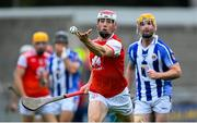 20 September 2020; Con O'Callaghan of Cuala handpasses the ball as Sephen O'Connor of Ballyboden St Enda's gives chase during the Dublin County Senior Hurling Championship Final match between Ballyboden St Enda's and Cuala at Parnell Park in Dublin. Photo by Piaras Ó Mídheach/Sportsfile