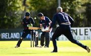 20 September 2020; Robert Gamble of YMCA is bowled by James Cameron-Dow of CIYMS watched by Chris Dougherty of CIYMS during the All-Ireland T20 European Cricket League Play-Off match between CIYMS and YMCA at CIYMS Cricket Club in Belfast. Photo by Sam Barnes/Sportsfile