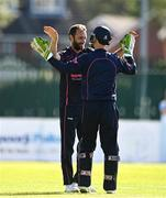 20 September 2020; Nigel Jones of CIYMS celebrates with wicket keeper Chris Dougherty after bowling Tim Tector of YMCA during the All-Ireland T20 European Cricket League Play-Off match between CIYMS and YMCA at CIYMS Cricket Club in Belfast. Photo by Sam Barnes/Sportsfile