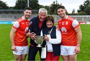 20 September 2020; Cuala players Seán, left, and David Treacy and their parents John and Fiona celebrate with The New Ireland Assurance Company Perpetual Challenge Cup after the Dublin County Senior Hurling Championship Final match between Ballyboden St Enda's and Cuala at Parnell Park in Dublin. Photo by Piaras Ó Mídheach/Sportsfile