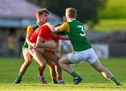 20 September 2020; Lee Brennan of Trillick St. Macartan's is fouled by Mark McKearney, left, and David Walsh of Dungannon Thomas Clarkes during the Tyrone County Senior Football Championship Final match between Trillick St. Macartan's and Dungannon Thomas Clarkes at Healy Park in Omagh, Tyrone. Photo by Ramsey Cardy/Sportsfile