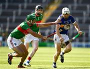 20 September 2020; Paul Flynn of Kiladangan is tackled by John Ryan, left, and Lorcan Egan of Loughmore-Castleiney during the Tipperary County Senior Hurling Championship Final match between Kiladangan and Loughmore-Castleiney at Semple Stadium in Thurles, Tipperary. Photo by Ray McManus/Sportsfile