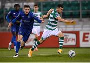 21 September 2020; Aaron Greene of Shamrock Rovers gets away from Waterford's Jake Davidson on his way to scoring his side's first goal during the SSE Airtricity League Premier Division match between Shamrock Rovers and Waterford at Tallaght Stadium in Dublin. Photo by Stephen McCarthy/Sportsfile