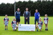 23 September 2020; Skryne GFC has been boosted with the news that it has claimed first prize in the 2020 Kellogg's GAA Cúl Camps on-pack promotion, claiming a huge €25,000 for the club. Pictured is David Byrne from Kellogg's with former Meath football's Damien Sheridan, Meath GAA Coaching & Games and Kellogg's GAA Cúl Camp co-ordinator, Trevor Giles Skryne GFC coach and, from left, Chris O'Connor, age 9, Katie O'Connor, age 11, Oisin Giles, age 10 and Emily Philips, age 11. Photo by Matt Browne/Sportsfile