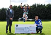 23 September 2020; Skryne GFC has been boosted with the news that it has claimed first prize in the 2020 Kellogg's GAA Cúl Camps on-pack promotion, claiming a huge €25,000 for the club. Pictured is David Byrne from Kellogg's, left, with former Meath football and Skryne GFC coach Trevor Giles and his 10 year old son Oisin. Photo by Matt Browne/Sportsfile
