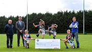 23 September 2020; Skryne GFC has been boosted with the news that it has claimed first prize in the 2020 Kellogg's GAA Cúl Camps on-pack promotion, claiming a huge €25,000 for the club. Pictured is, from left, Senan McGrath, Chair of Skryne GFC Club, David Byrne from Kellogg's, Katie O'Connor, age 11, Emily Philips, age 11, Chris O'Connor, age 9, Oisin Giles, age 10, former Meath football and Skryne GFC coach Trevor Giles. Photo by Matt Browne/Sportsfile
