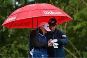 25 September 2020; Padraig Harrington of Ireland checks his notes with caddie Ronan Flood on the second tee box during day two of the Dubai Duty Free Irish Open Golf Championship at Galgorm Spa & Golf Resort in Ballymena, Antrim. Photo by Brendan Moran/Sportsfile