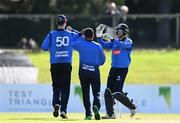 26 September 2020;  Lorcan Tucker of Leinster Lightning, right, celebrates with team-mates Simi Singh, centre, and George Dockrell after stumping James McCollum of Northern Knights during the Test Triangle Inter-Provincial Series 50 over match between Leinster Lightning and Northern Knights at Malahide Cricket Club in Dublin. Photo by Sam Barnes/Sportsfile