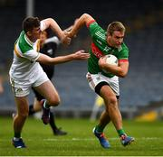 27 September 2020; John McGrath of Loughmore-Castleiney in action against Séamus Kennedy of Clonmel Commercials during the Tipperary County Senior Football Championship Final match between Clonmel Commercials and Loughmore-Castleiney at Semple Stadium in Thurles, Tipperary. Photo by Ray McManus/Sportsfile