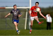 27 September 2020; Karl Faulkner of Ardee St Mary's in action against Conor Whelan of Naomh Mairtin during the Louth County Senior Football Championship Final match between Naomh Mairtin and Ardee St Mary's at Darver Louth Centre of Excellence in Louth. Photo by Ben McShane/Sportsfile