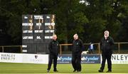 28 September 2020; Umpires Paul Reynolds, left, and Mark Hawthorne, centre, along with match referee Kevin Gallagher, walk the pitch as rain delays play during the Test Triangle Inter-Provincial Series 50 over match between Leinster Lightning and North-West Warriors at Malahide Cricket in Dublin. Photo by Sam Barnes/Sportsfile