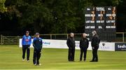 28 September 2020;  George Dockrell of Leinster Lightning, left, and Andy McBrine of North West Warriors, second from left, inspect the pitch, alongside umpires Paul Reynolds, third from left, Mark Hawthorne, second from right, and match referee Kevin Gallagher during the Test Triangle Inter-Provincial Series 50 over match between Leinster Lightning and North-West Warriors at Malahide Cricket in Dublin. Photo by Sam Barnes/Sportsfile