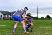 27 September 2020; Evan Whelan, right, of Naomh Mairtin with team-mate Conor Smyth, 21, following their side's victory in the Louth County Senior Football Championship Final match between Naomh Mairtin and Ardee St Mary's at Darver Louth Centre of Excellence in Louth. Photo by Ben McShane/Sportsfile