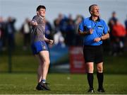 27 September 2020; Mark Whelan of Naomh Mairtin watches his kick for a point go over the bar with referee Paul Kneel during the Louth County Senior Football Championship Final match between Naomh Mairtin and Ardee St Mary's at Darver Louth Centre of Excellence in Louth. Photo by Ben McShane/Sportsfile