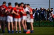 27 September 2020; Naomh Mairtin supprters look on as Ardee St Mary's players huddle ahead of the Louth County Senior Football Championship Final match between Naomh Mairtin and Ardee St Mary's at Darver Louth Centre of Excellence in Louth. Photo by Ben McShane/Sportsfile