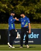 28 September 2020; Stuart Thompson of North West Warriors, left, celebrates with Varun Chopra after catching Simi Singh of Leinster Lightning during the Test Triangle Inter-Provincial Series 50 over match between Leinster Lightning and North-West Warriors at Malahide Cricket in Dublin. Photo by Sam Barnes/Sportsfile