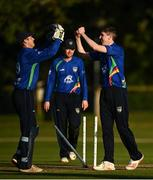 28 September 2020; Conor Olphert of North West Warriors, right, celebrates with Will Smale, left, after bowling Greg Ford of Leinster Lightning during the Test Triangle Inter-Provincial Series 50 over match between Leinster Lightning and North-West Warriors at Malahide Cricket in Dublin. Photo by Sam Barnes/Sportsfile