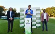 28 September 2020; Leinster Lightning captain George Dockrell lifts the IP50 trophy, alongside Cricket Ireland president Philip Black, left, and Praveen Madire, CEO of Test Triangle during the Test Triangle Inter-Provincial Series 50 over match between Leinster Lightning and North-West Warriors at Malahide Cricket in Dublin. Photo by Sam Barnes/Sportsfile
