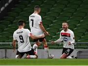 1 October 2020; Michael Duffy of Dundalk, centre, celebrates with team-mates Sean Murray, right, and Patrick Hoban after scoring their side's first goal during the UEFA Europa League Play-off match between Dundalk and Ki Klaksvik at the Aviva Stadium in Dublin. Photo by Ben McShane/Sportsfile