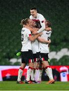 1 October 2020; Dundalk players, from left, Greg Sloggett, Sean Hoare, Darragh Leahy, top, Daniel Cleary, hidden, and John Mountney celebrate following the UEFA Europa League Play-off match between Dundalk and Ki Klaksvik at the Aviva Stadium in Dublin. Photo by Stephen McCarthy/Sportsfile