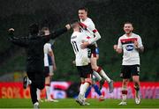 1 October 2020; Daniel Kelly, centre, celebrates with Dundalk team-mates Patrick McEleney, 11, and Sean Murray following the UEFA Europa League Play-off match between Dundalk and Ki Klaksvik at the Aviva Stadium in Dublin. Photo by Stephen McCarthy/Sportsfile