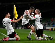 1 October 2020; Sean Murray, right, celebrates with Dundalk team-mates Michael Duffy and Patrick Hoban, left, after scoring his side's opening goal during the UEFA Europa League Play-off match between Dundalk and Ki Klaksvik at the Aviva Stadium in Dublin. Photo by Stephen McCarthy/Sportsfile
