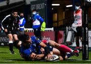 2 October 2020; James Lowe of Leinster dives over to score his side's fourth try despite the tackle of Jonah Holmes of Dragons during the Guinness PRO14 match between Leinster and Dragons at the RDS Arena in Dublin. Photo by Harry Murphy/Sportsfile