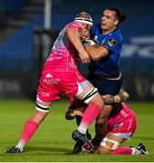 2 October 2020; James Lowe of Leinster is tackled by Joe Davies and Ross Moriarty of Dragons during the Guinness PRO14 match between Leinster and Dragons at the RDS Arena in Dublin. Photo by Brendan Moran/Sportsfile