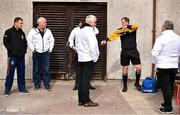 4 October 2020; Referee Alan Long, second from right, gets changed outside surrounded by his umpires ahead of the Cork County Premier Senior Football Championship Semi-Final match between Nemo Rangers and Duhallow at Páirc Ui Rinn in Cork. Photo by Sam Barnes/Sportsfile