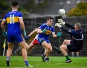 4 October 2020; Conor Rooney of Ratoath has a shot at goal saved by Gaeil Colmcille goalkeeper Justin Carry-Lynch during the Meath County Senior Football Championship Final match between Ratoath and Gaeil Colmcille at Páirc Táilteann in Navan, Meath. Photo by Brendan Moran/Sportsfile